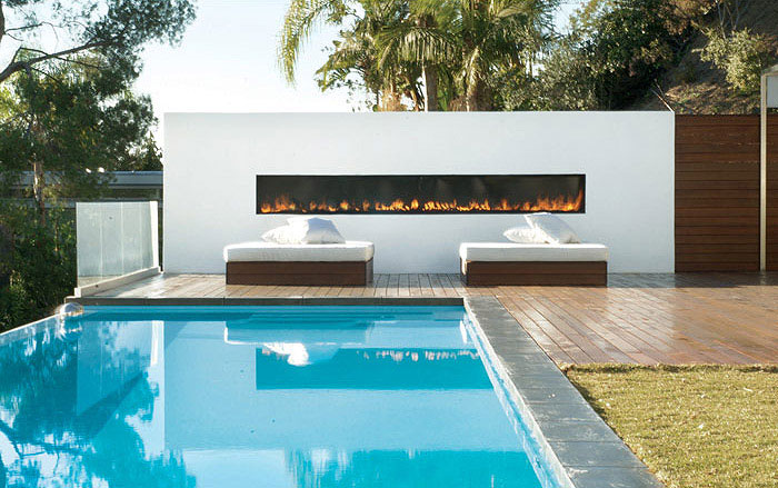 The Hollywood Dream House pool house outdoor fire place