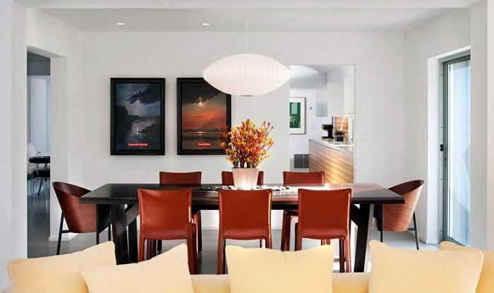 Light Interior Design in 1426 Greenworth Place dining table red chairs