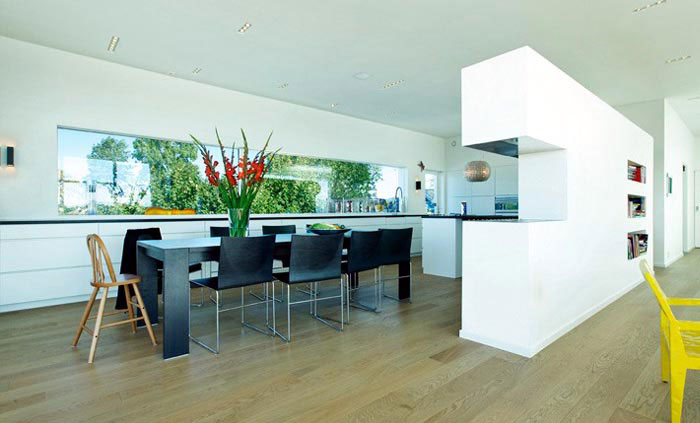 Modern House by Todd Saunders kitchen dining area