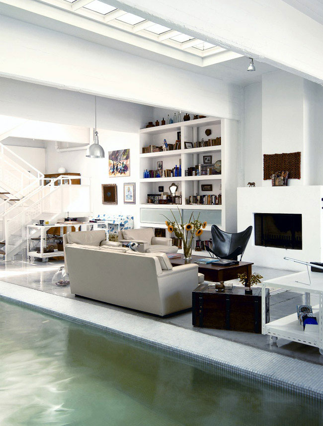 House with a Pool Inside white shelves livingroom