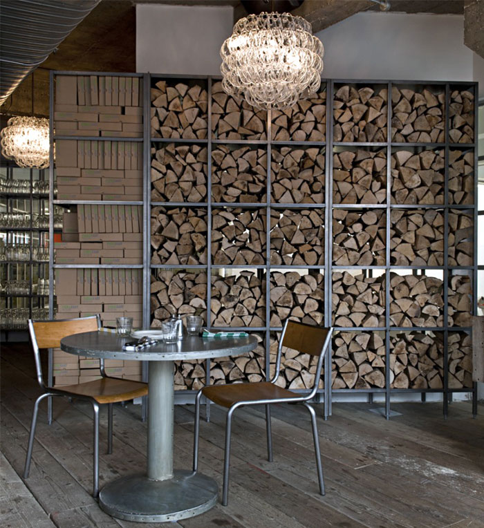Interior decor at pizza east interiorzine - Rack a bois de chauffage ...