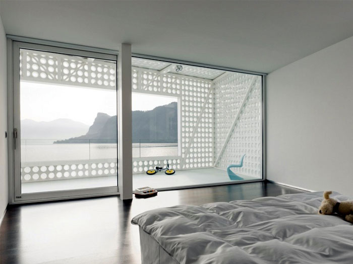 Sculptural Villa in Swtzerland white concrete interior bedroom