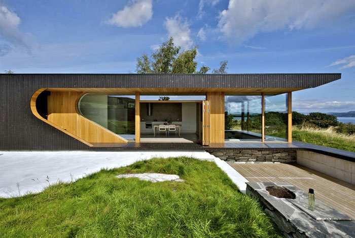 House With Folding Doors house opens up facade