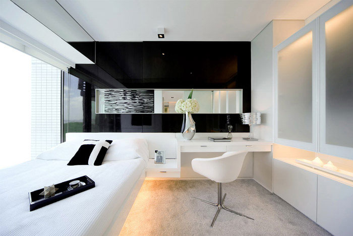 Water Rhythm victoria bay front apartment interior whit bedroom
