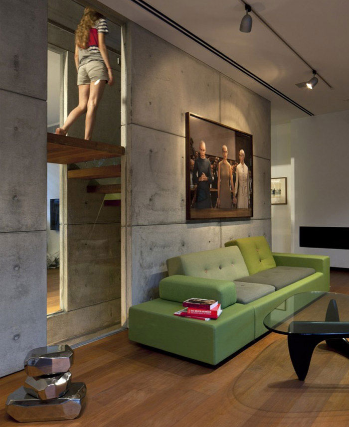 The House Is A Row House Nested Within The Dense Urban Fabric Of The