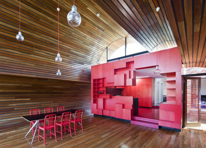 Cloud House playful geometry red kitchen