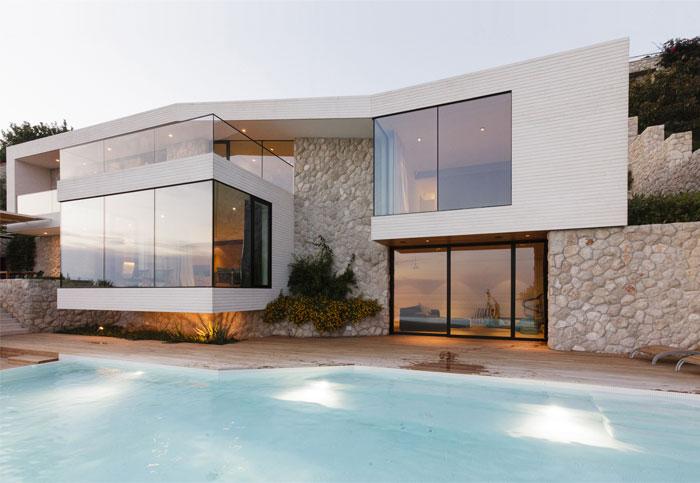 Mediterranean House With Large Glass Windows Interiorzine