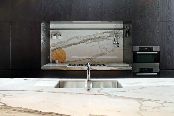 dark-timber-calcutta-marble-kitchen