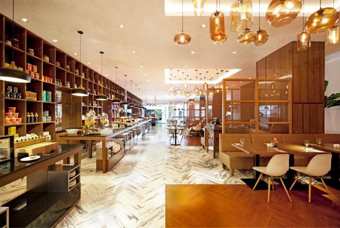 Nhà hàng tươi sáng và rộng rãi bởi Designphase DBA nhà hàng màu caramel vàng mật ong nội thất