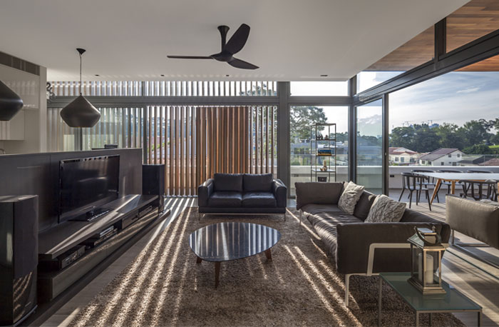 vertical-timber-louvers-punctuated-clear-glass-bay-windows