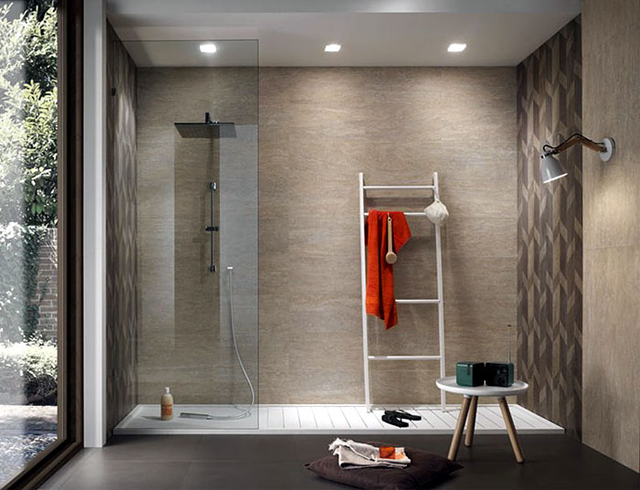 New line floor and wall tiles design by diego grandi for Ceramic tile designs for bathroom walls