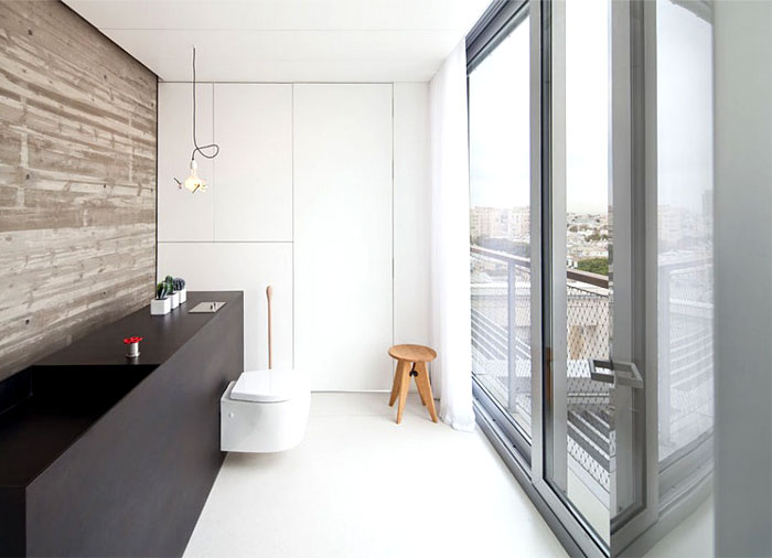 exposed-concrete-wall-stark-white-design