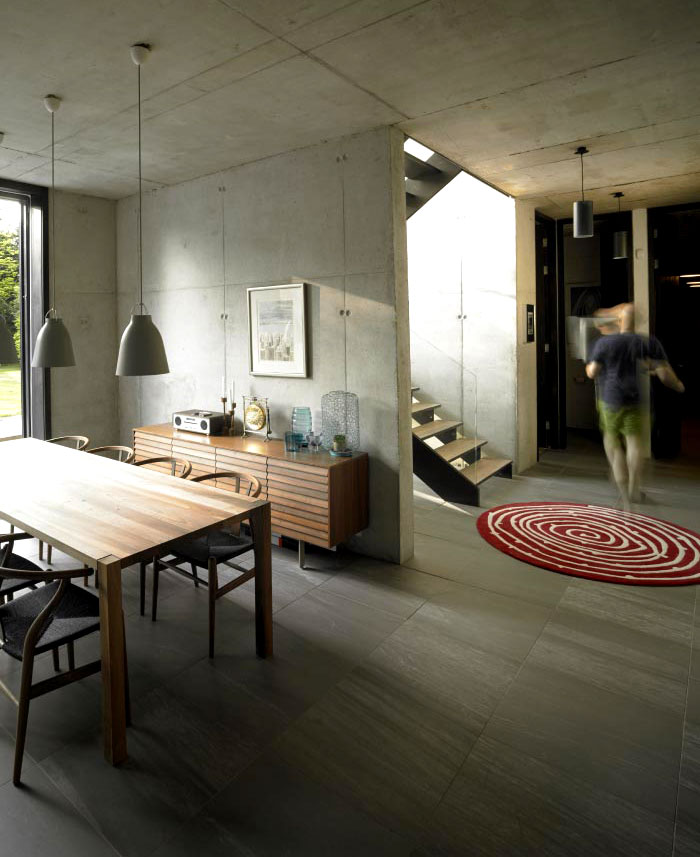 Suburban Home With Concrete Structure That Is Exposed Throughout The Interior Interiorzine