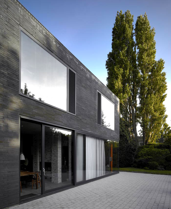 Suburban home with concrete structure that is exposed for Concrete exterior walls
