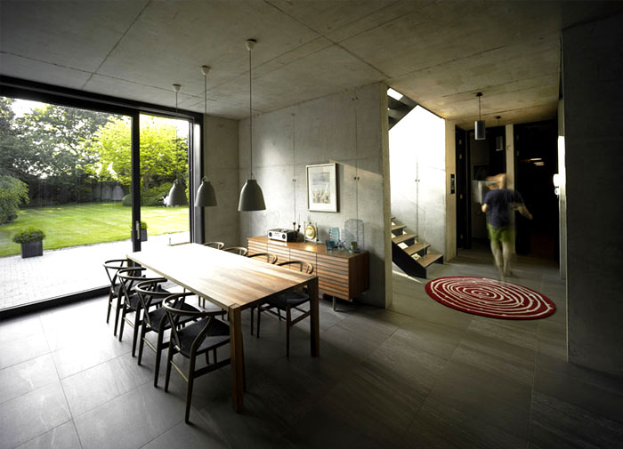 Suburban Home With Concrete Structure That Is Exposed Throughout The Interior