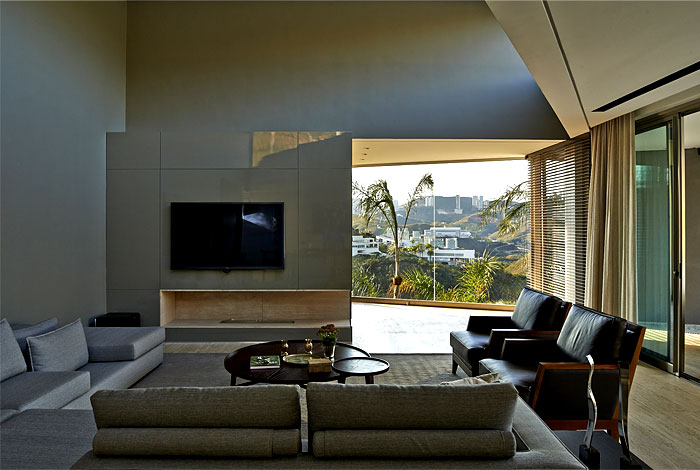 Style and clear elegance at vale dos cristais residence for Neutral palette living room