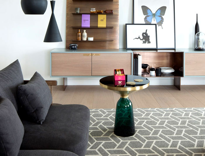 living-area-geometric-rug-flanked-two-sofas
