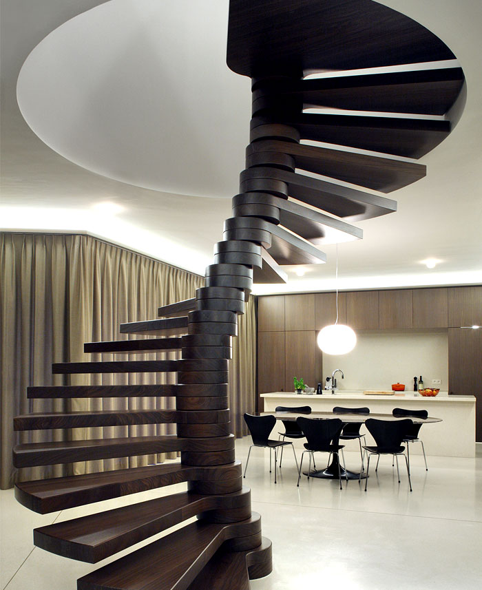 Symmetrical tripartite villa moerkensheide for Architecture spiral staircase