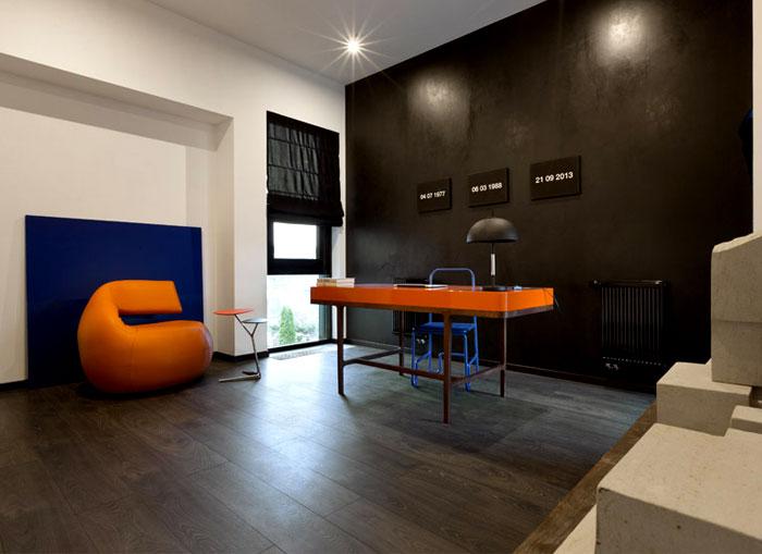 office-matte-black-walls-vibrant-orange-blue-furniture
