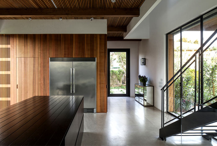 black-steel-cedar-panels-gray-concrete-interior-1