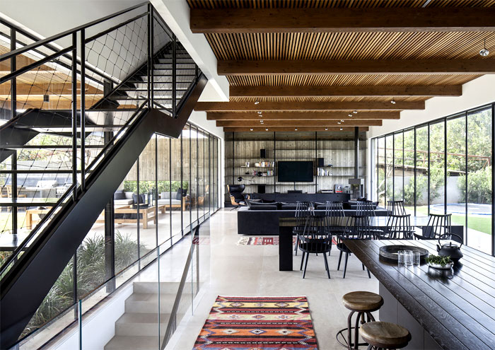 black-steel-cedar-panels-gray-concrete-interior