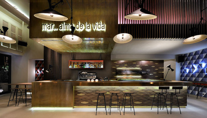 Cafe Bar Decorated With Geometric Shapes of 1960s - InteriorZine