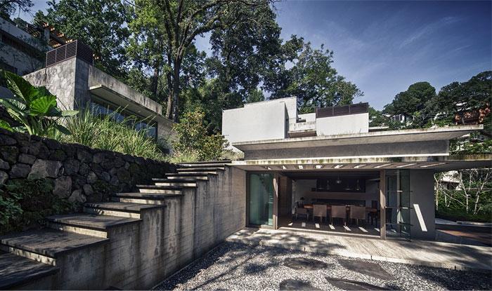 raw-concrete-house-integrated-vegetation