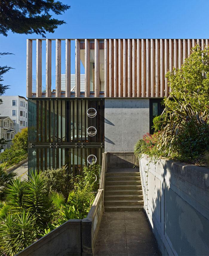 three-story-high-glass-tower-concrete-garage