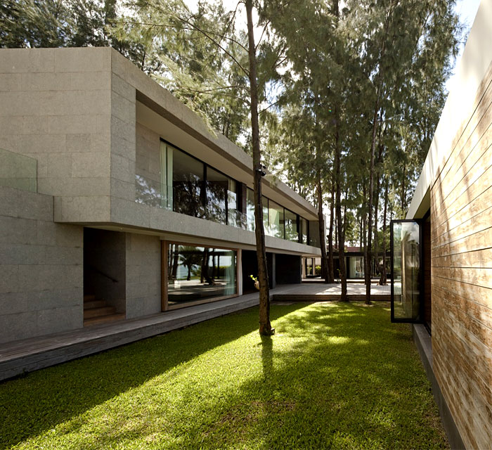 house incorporate natural stones wood brick clear glass