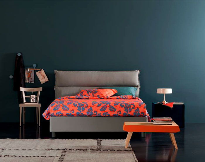 colored bedroom textiles against gray walls