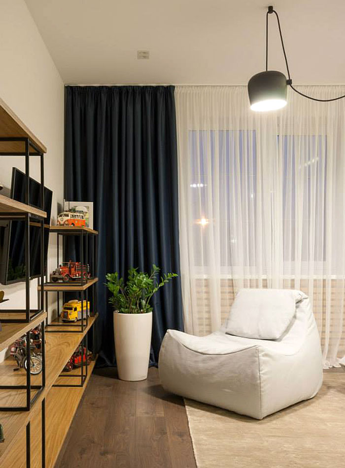 bedroom-detail-soft-seat-and-dark-blue-curtain