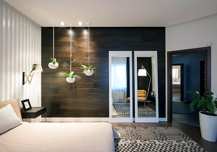 wooden-bedroom-wall-two-mirrors-greenery