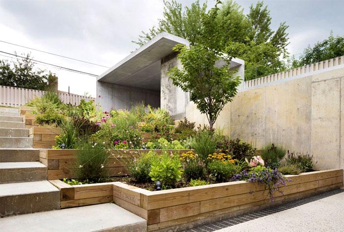 secluded back garden concrete partitions wooden terraces