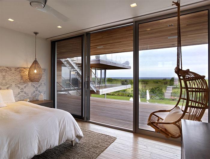 floor to ceiling windows bedroom