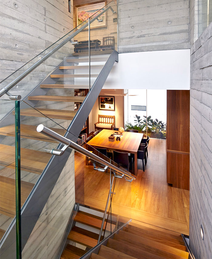 exposed concrete raw wood staircase