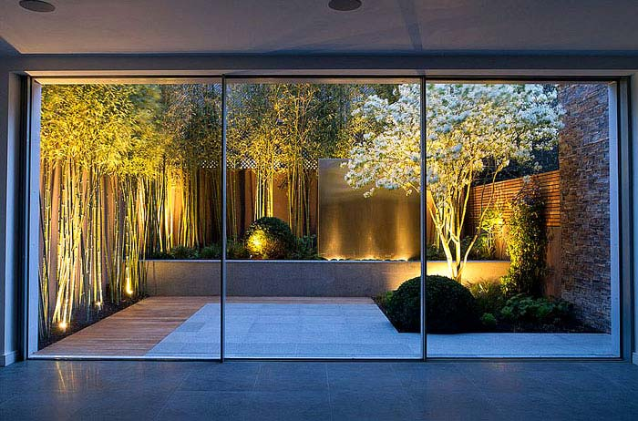 Bamboo white flowers and a water feature small garden