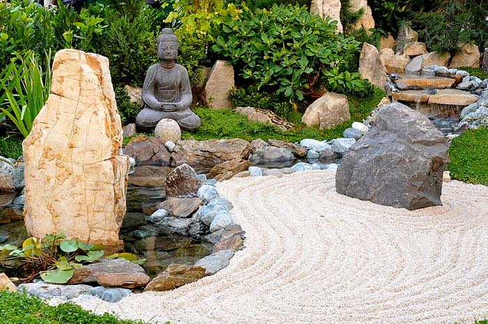 rock zen garden with buddha statue