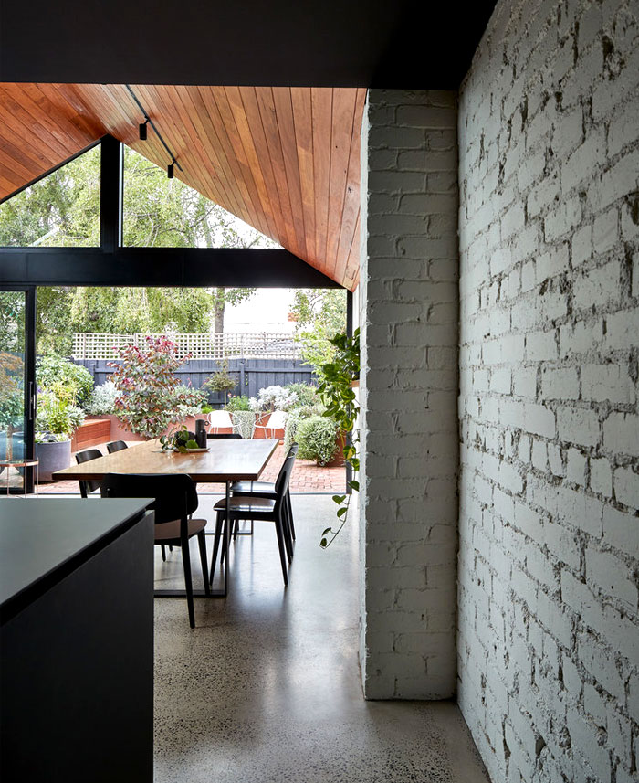 a for architecture transforms cottage two story home 2