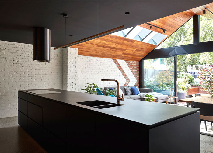 a for architecture transforms cottage two story home 9