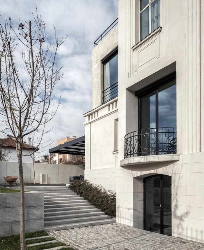 white concrete old house io architects 19