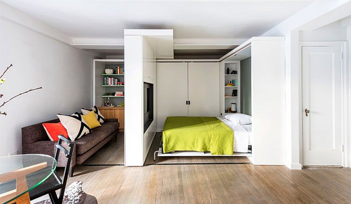 folding wall bed hidden behind movable wall