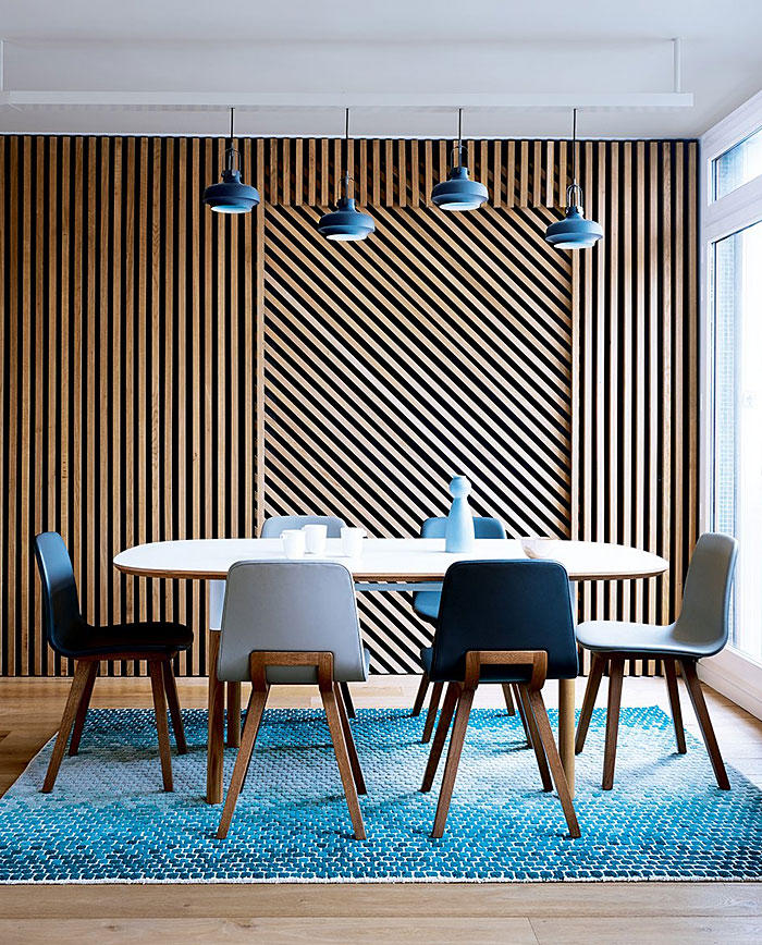 hide the bed behind a wooden decorative partition