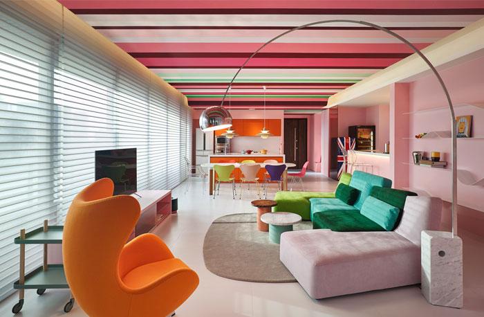 orange color open plan living room kitchen