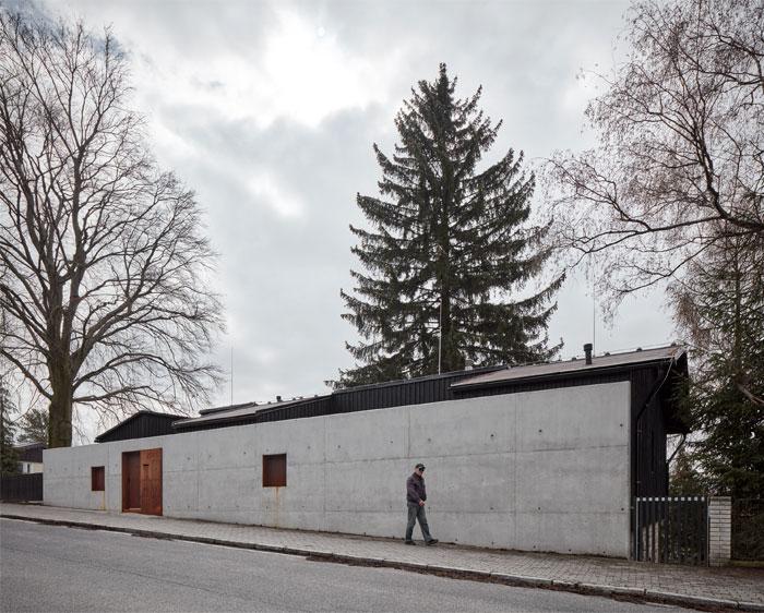 house behind wall mjolk architects 11