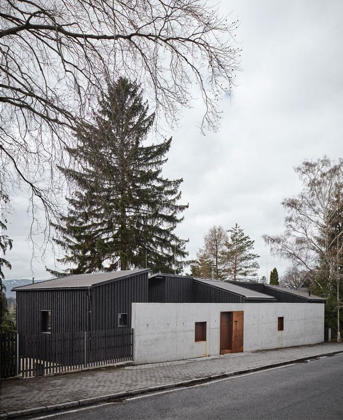 house behind wall mjolk architects 12