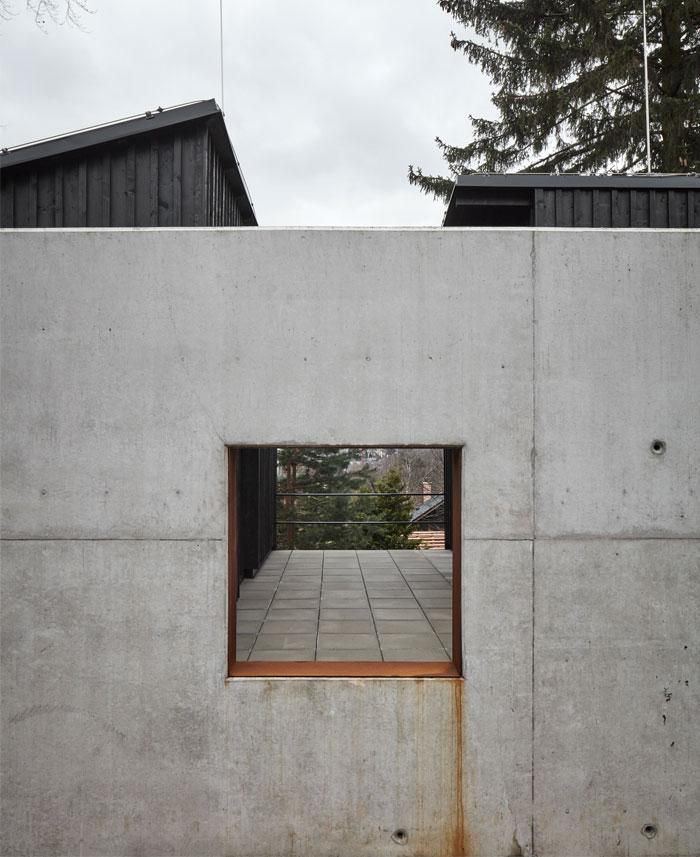 house behind wall mjolk architects 7