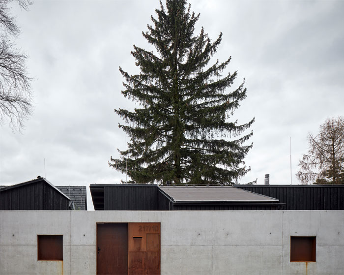 house behind wall mjolk architects 8