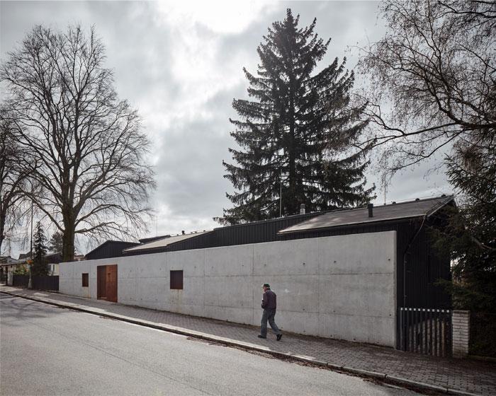 house behind wall mjolk architects 9